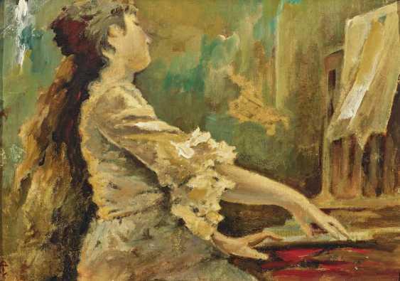 Young woman at the piano - photo 1