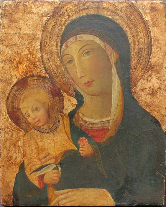 Sano di Pietro (1406-1481)-manner, Madonna with Child holding a flower - photo 1
