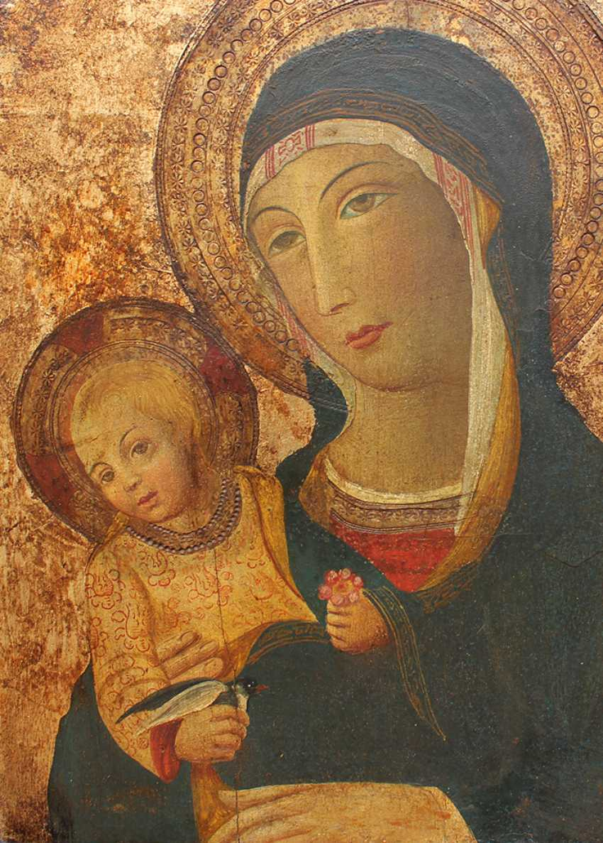 Sano di Pietro (1406-1481)-manner, Madonna with Child holding a flower - photo 2