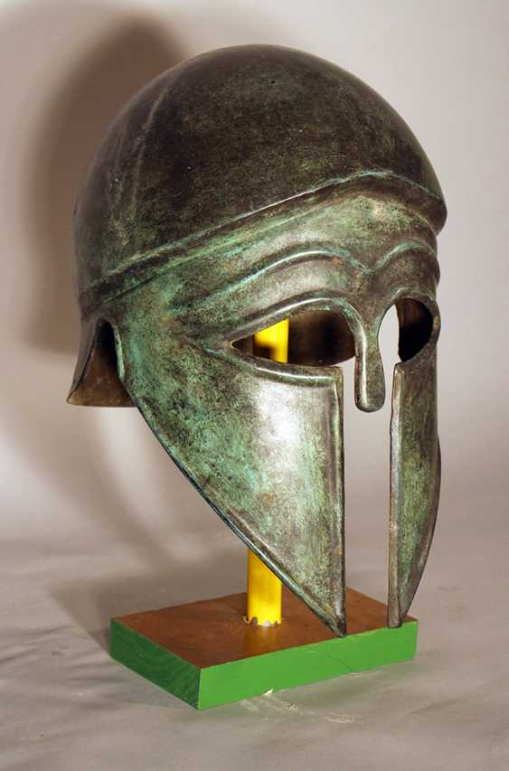 Corinthian bronze helmet in ancient style with open work eyes and nose protection, chased border lines and forehead deocrations - photo 1