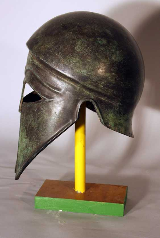 Corinthian bronze helmet in ancient style with open work eyes and nose protection, chased border lines and forehead deocrations - photo 2