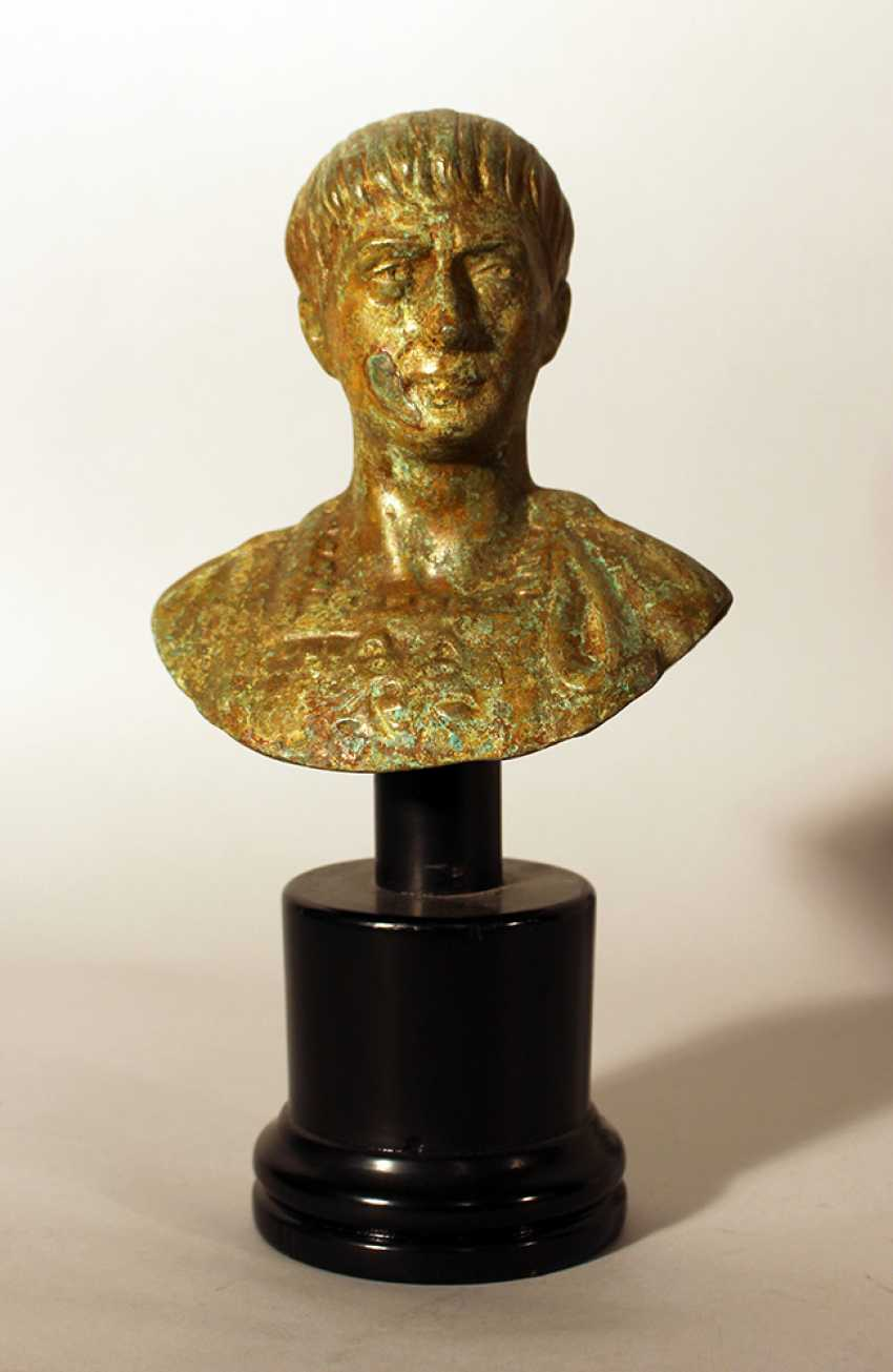 Bronze bust of Roman emperor Augustus in ancient manner, looking to the side, in armour - photo 1