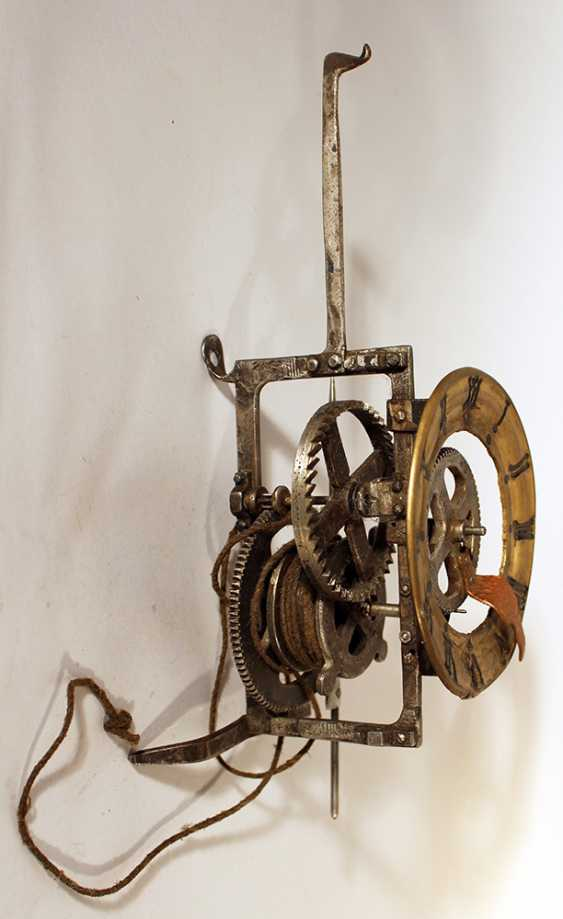 Iron clock movement with later bronze dial with Roman numbers and copper finger - photo 1