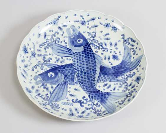 Japanese porcelain dish with blue painted fishers and decorations on white ground, glazed - photo 1