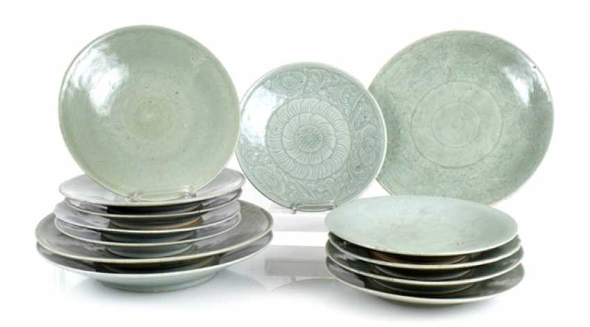 Three of the ten plates with celadon glaze, some with floral decor - photo 1