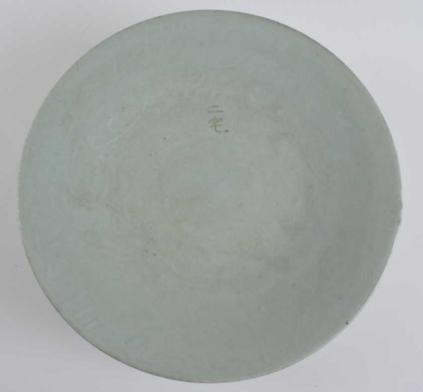 Three of the ten plates with celadon glaze, some with floral decor - photo 2