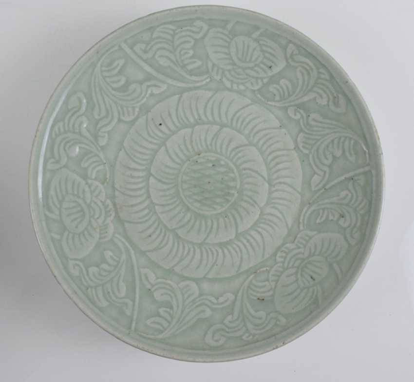 Three of the ten plates with celadon glaze, some with floral decor - photo 3