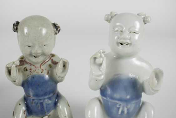 Five porcelain boy in a sitting posture - photo 3