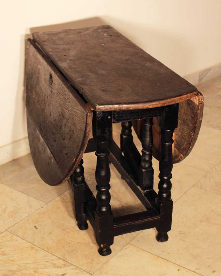 English gateleg oakwood table, oval top on four turned feet with upper and lower connection, with two extendable movable turned feet - photo 3
