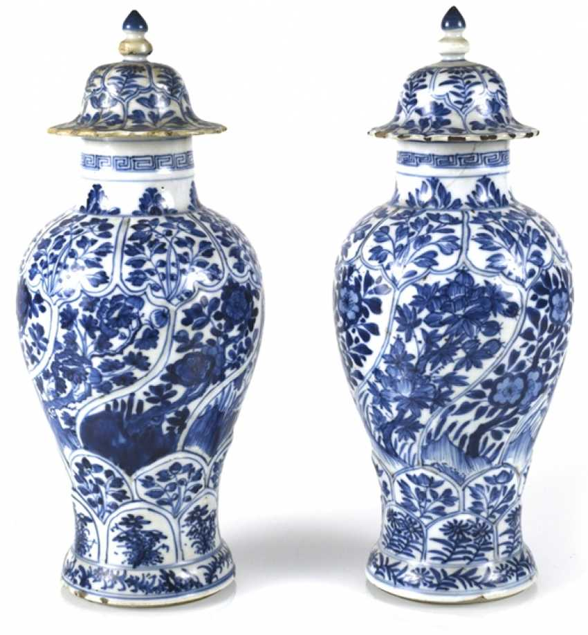 Two under glaze blue vases, made of porcelain with floral decor - photo 1