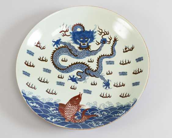 Chinese porcelain dish with painted blue and red dragon, fish and other decorations, on white ground, glazed - photo 1