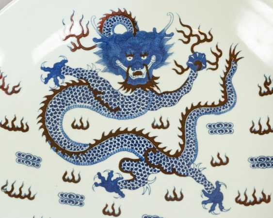 Chinese porcelain dish with painted blue and red dragon, fish and other decorations, on white ground, glazed - photo 2