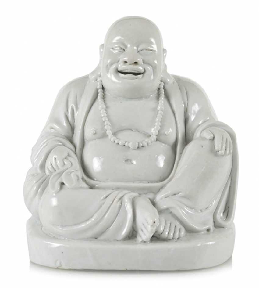 Dehua figure of a seated Budai - photo 1