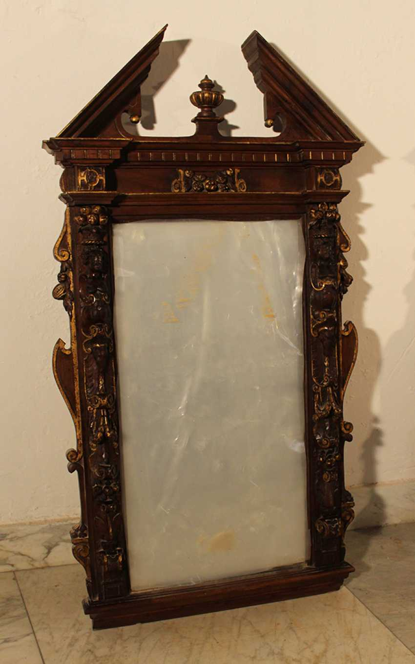 Pair of French mirrors in manieristic manner with roof top and rich figural and ornamental carvings on all sides, partly gilded - photo 3