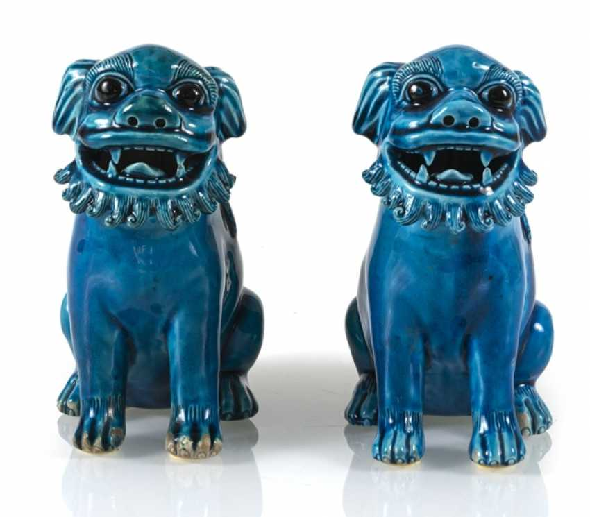 Pair of turquoise glazed lion from biscuit porcelain - photo 1