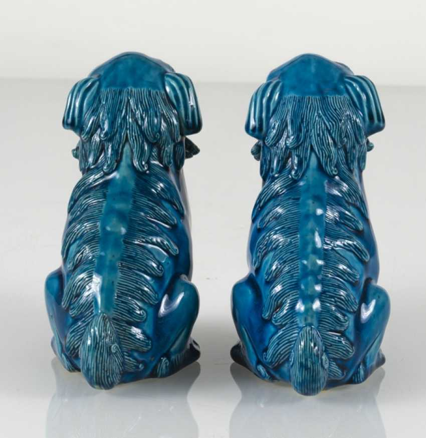 Pair of turquoise glazed lion from biscuit porcelain - photo 3