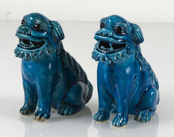 Pair of turquoise glazed lion from biscuit porcelain - photo 5
