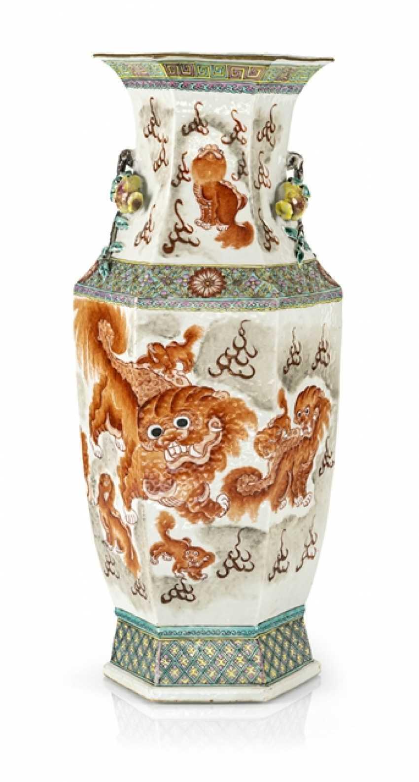 Hexagonal Vase with lion decoration and plastic pomegranates - photo 1