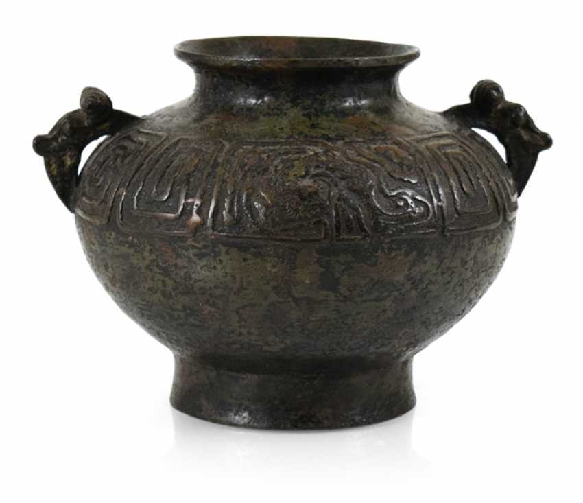 Henkel pot made of Bronze with a revolving relief decoration on the shoulder - photo 1