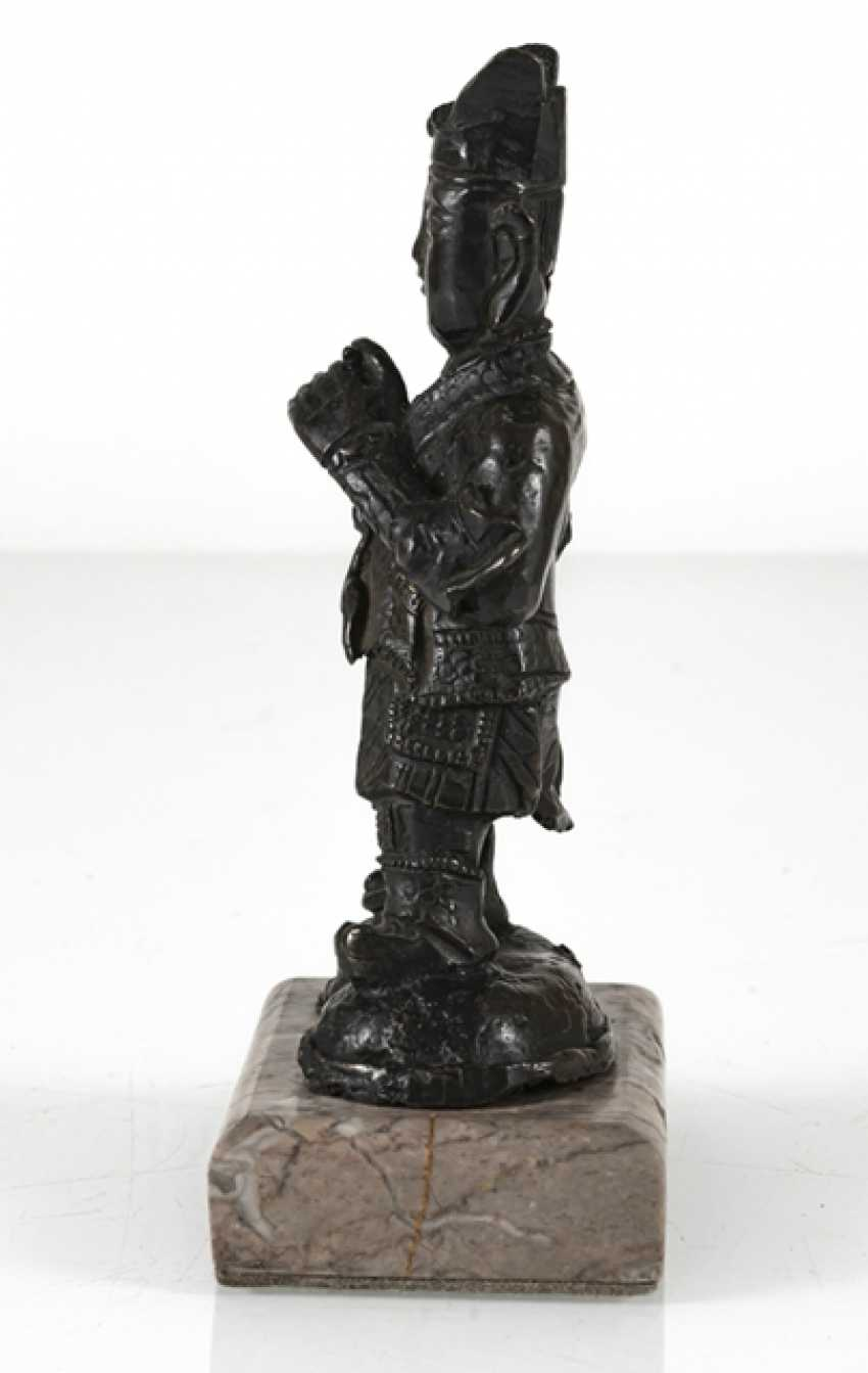 Bronze of a standing guard on a stone plinth - photo 2