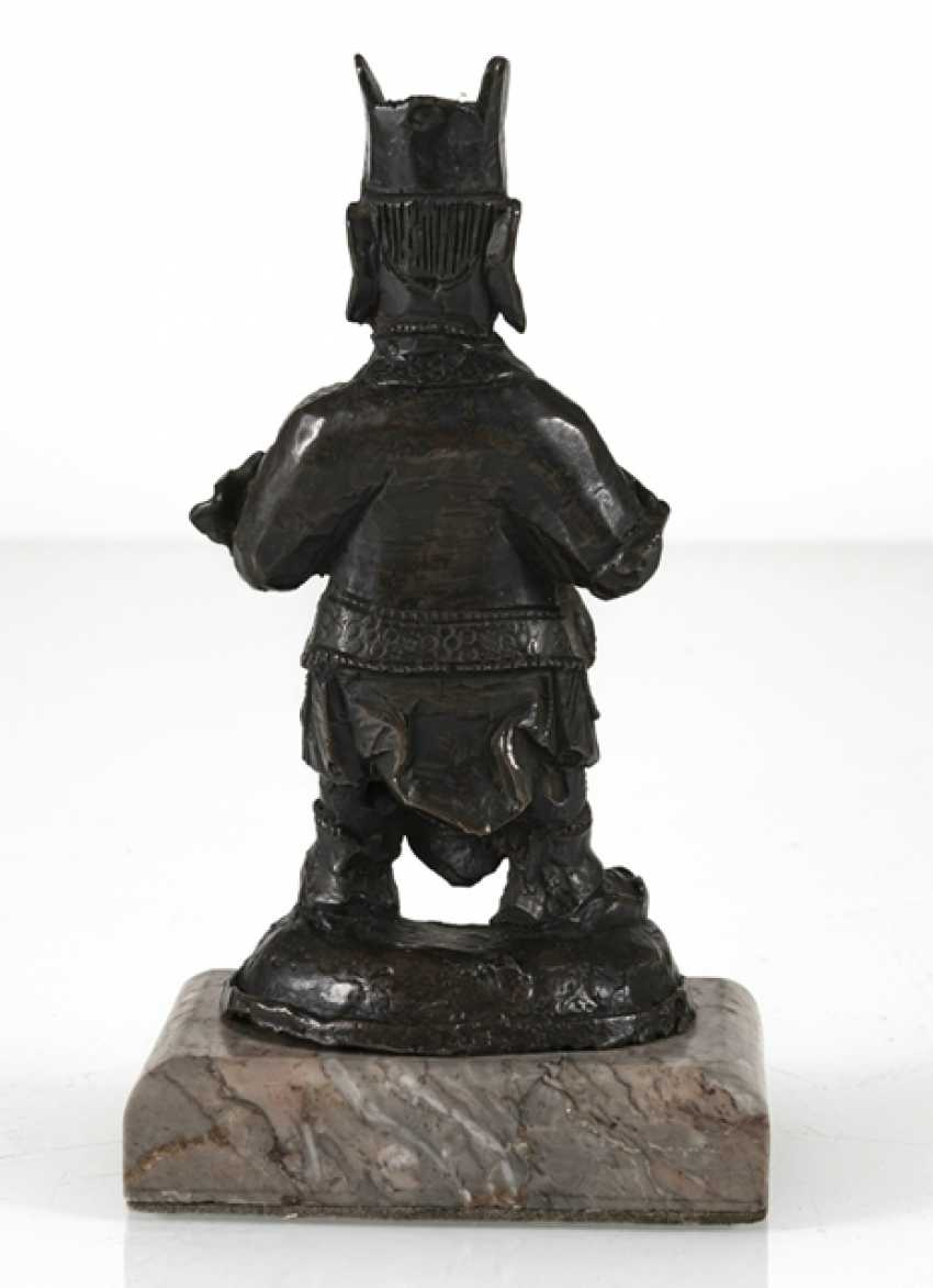Bronze of a standing guard on a stone plinth - photo 3