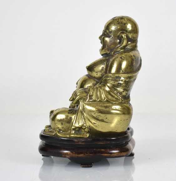 Bronze figure of the seated Budai - photo 3