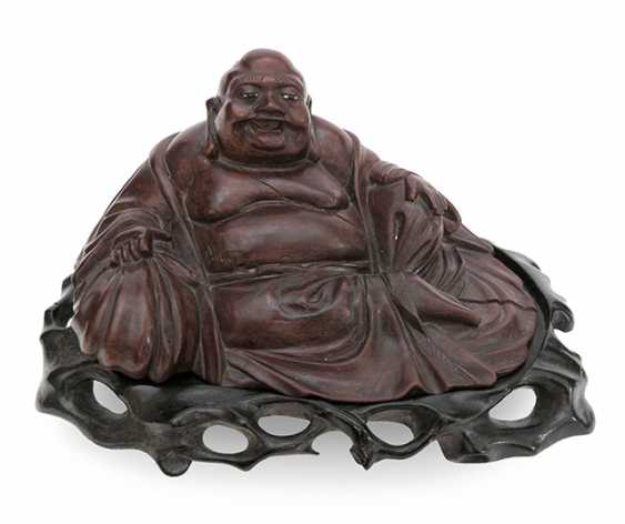 The wooden figure on his bag seated Budai - photo 1