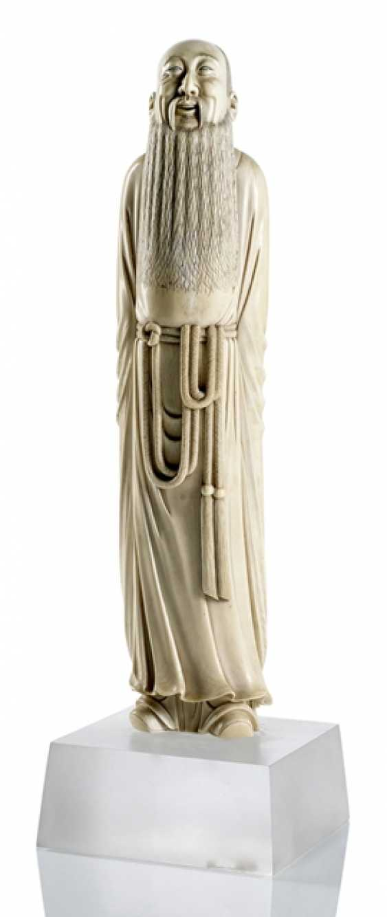 Figure of a standing scholar from the ivory - photo 1