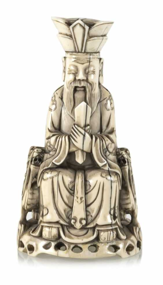 A fine ivory figure of a seated Taoist Official - photo 1