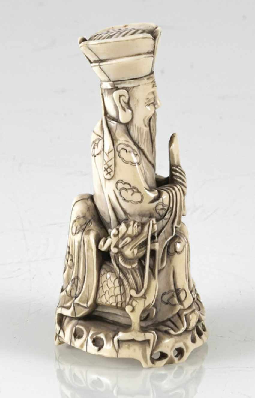 A fine ivory figure of a seated Taoist Official - photo 4