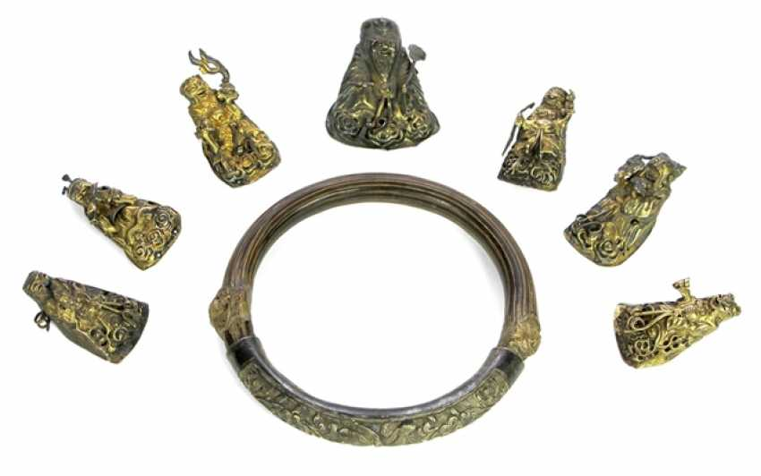 Seven appliqués in the Form of lucky gods and a bangle with a fine Silver - photo 1