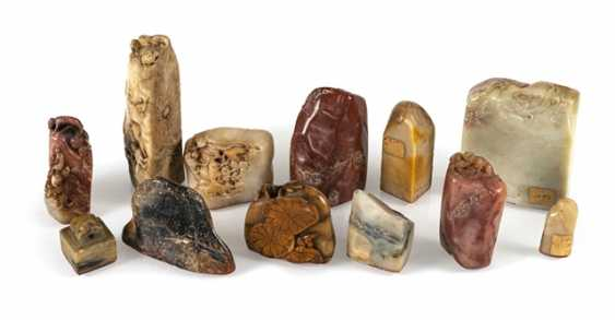 Twelve seals in various materials including Jade and soapstone - photo 1