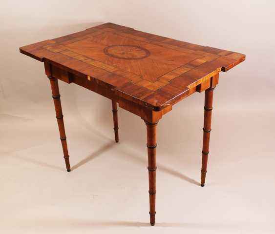 Louis XVI game table in rectangular shape with canted border and richly ornamental and geometrical decorated top, with intarsias in plum, cherry and maple wood - photo 2