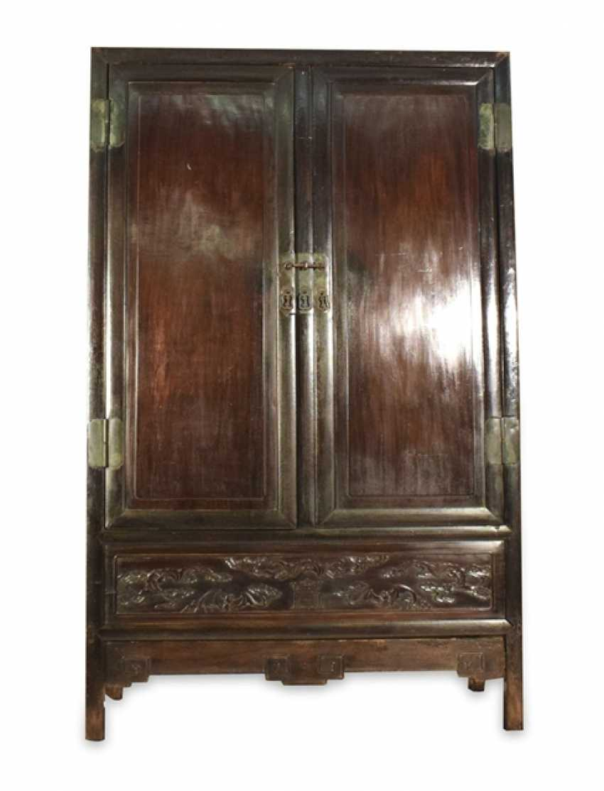 Two door Cabinet made of hard wood with a boost with bat decor - photo 1