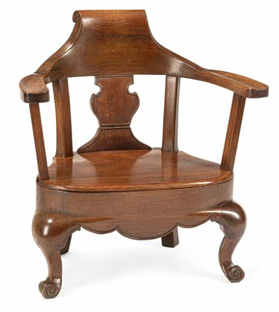 Low chair with wide armrests made of hardwood and the chair in the Form of an officers cap - photo 1