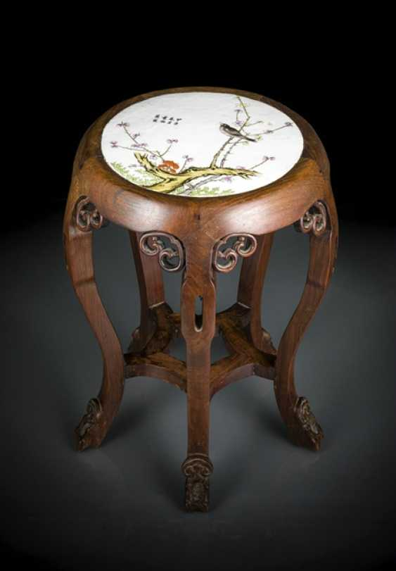 Stool made of wood with inlaid porcelain plate with bird decoration and inscription - photo 1