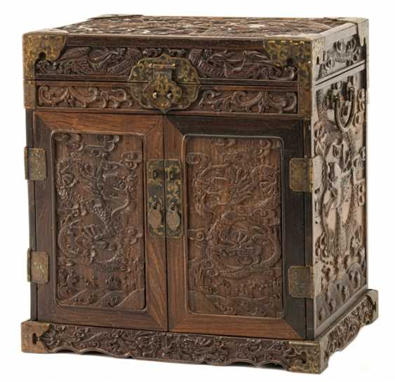 A small hardwood Cabinet with carved decor and relapses - photo 1