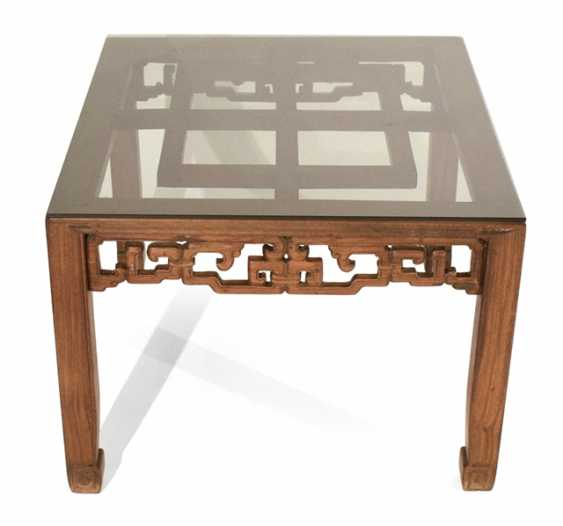 A flat table of hard wood with glass top - photo 1