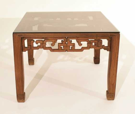 A flat table of hard wood with glass top - photo 2
