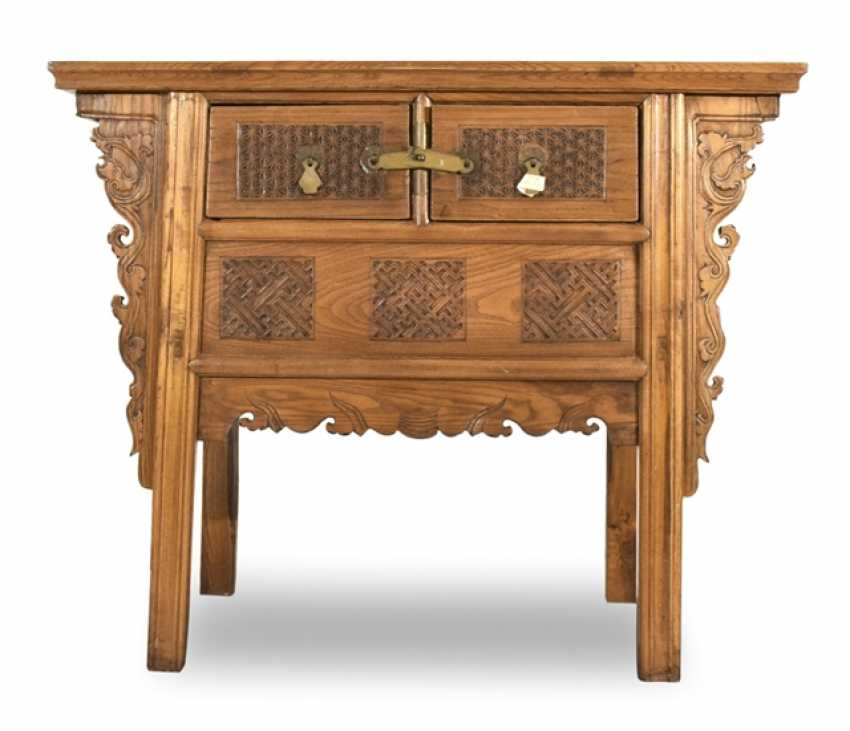 Wooden chest of drawers with two relapses and ornate frames - photo 1