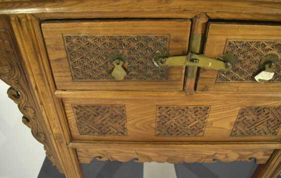 Wooden chest of drawers with two relapses and ornate frames - photo 2