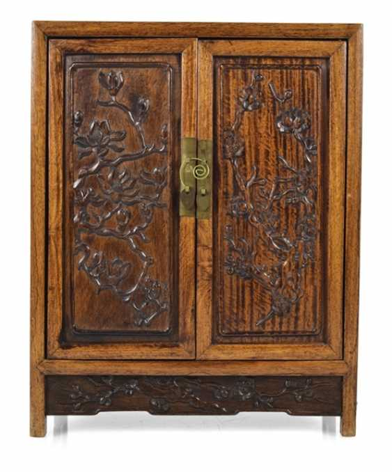 Small Cabinet made of hard wood with carved and seven relapses - photo 1