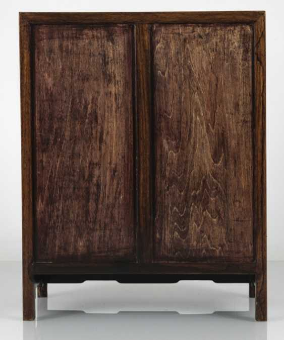 Small Cabinet made of hard wood with carved and seven relapses - photo 3