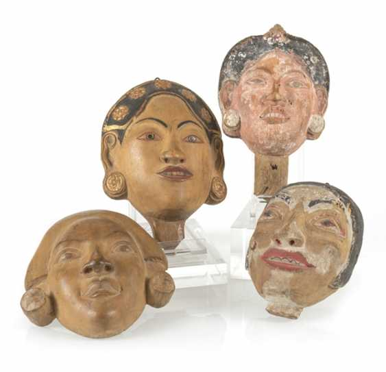Four wood carvings in the Form of masks - photo 1
