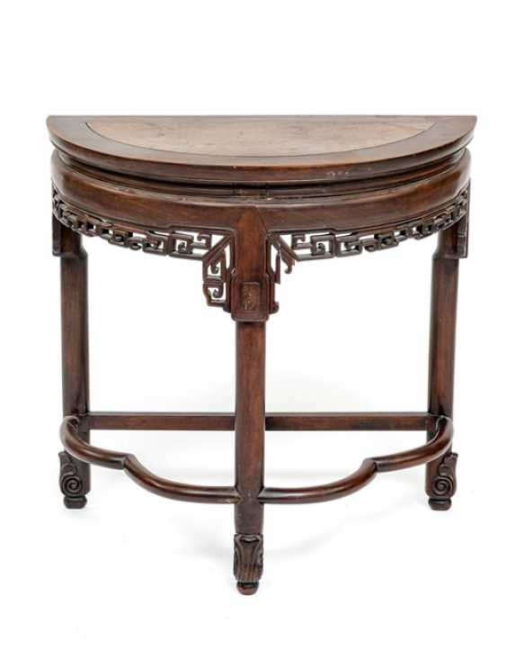 Half round table made of hard wood with carved frame - photo 1