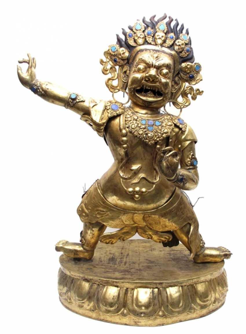 Big fire-gilded repoussé technology-figure of the Dharmapala - photo 1