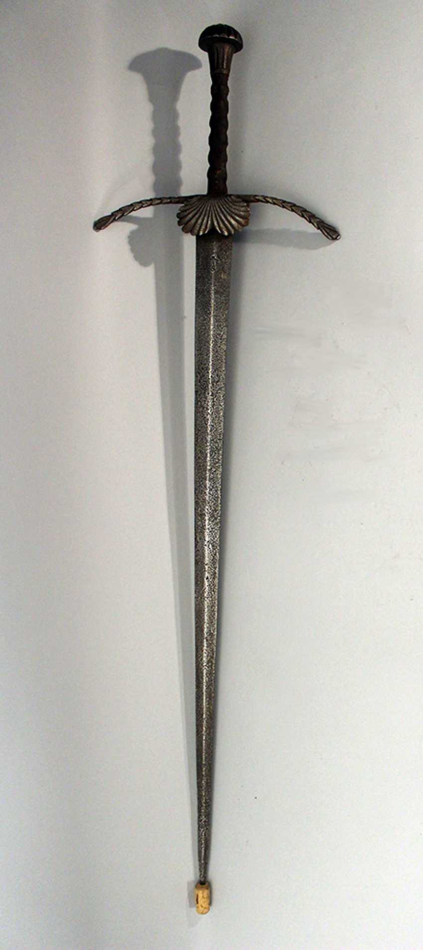 Bihänder or execution sword with long concave blade and maker's sign in the upper part - photo 1