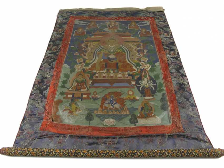 Thangka with the depiction of the crowned Buddha Shakyamuni - photo 1