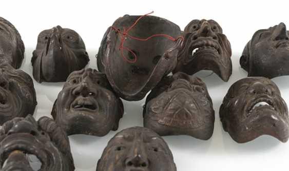 Set with twelve small Gigaku-masks made of wood with varnish edition - photo 4