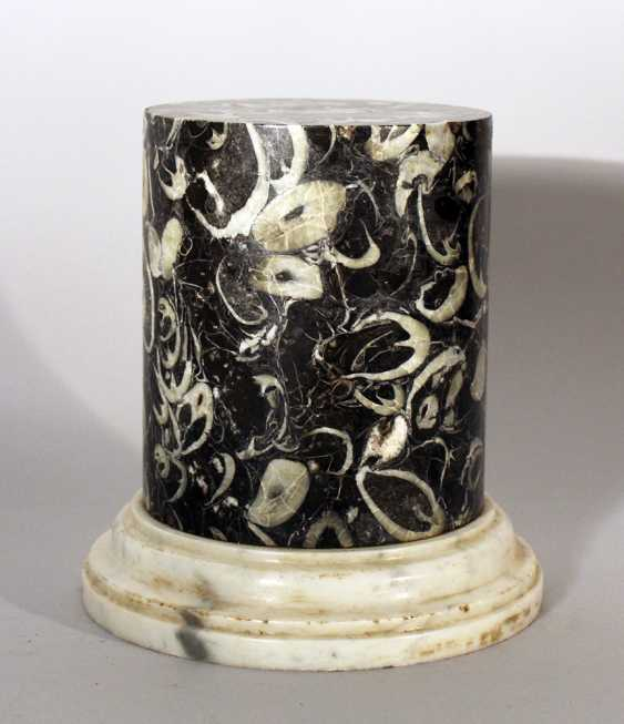 A small column with fossil inclusions in black polished stone - photo 3